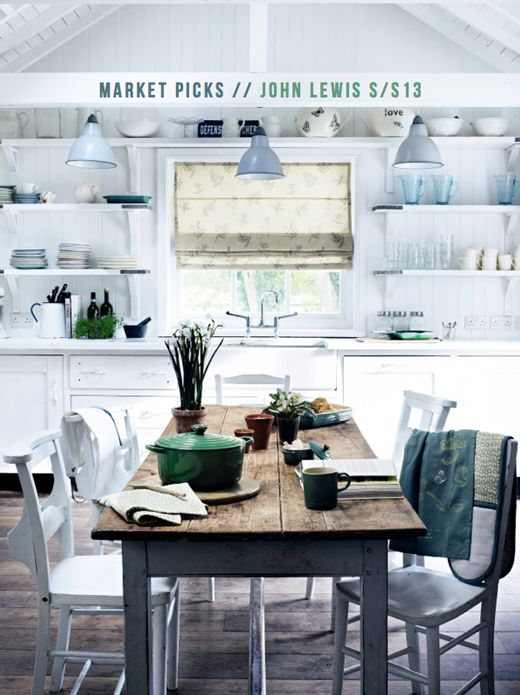 green tableware, fresh greenery and a green blanket make the kitchen fresher and brighter