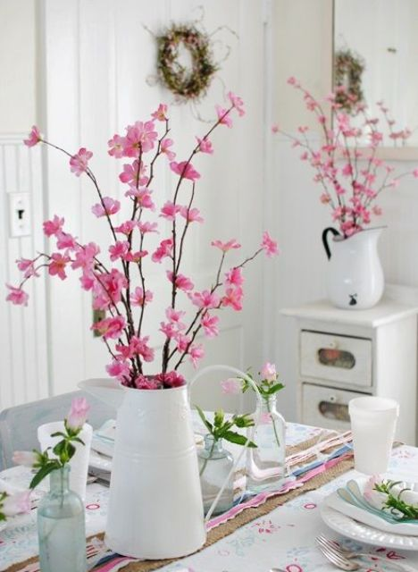 cherry blossom and pink roses make the kitchen feel more spring or summer-like and bright