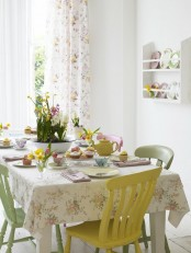 floral linens, pastel chairs, pastel tableware and plates make the dining space look more spring-like