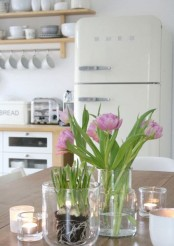pink blooms and fresh bulbs in clear vases will brign a subtle touch of spring to your space