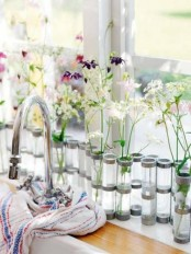 test tubes with lots of wildflowers and bold blooms are a cool spring-like decoration