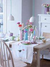 pastel tableware, bright blooms and pastel napkins make the kitchen feel more spring-like