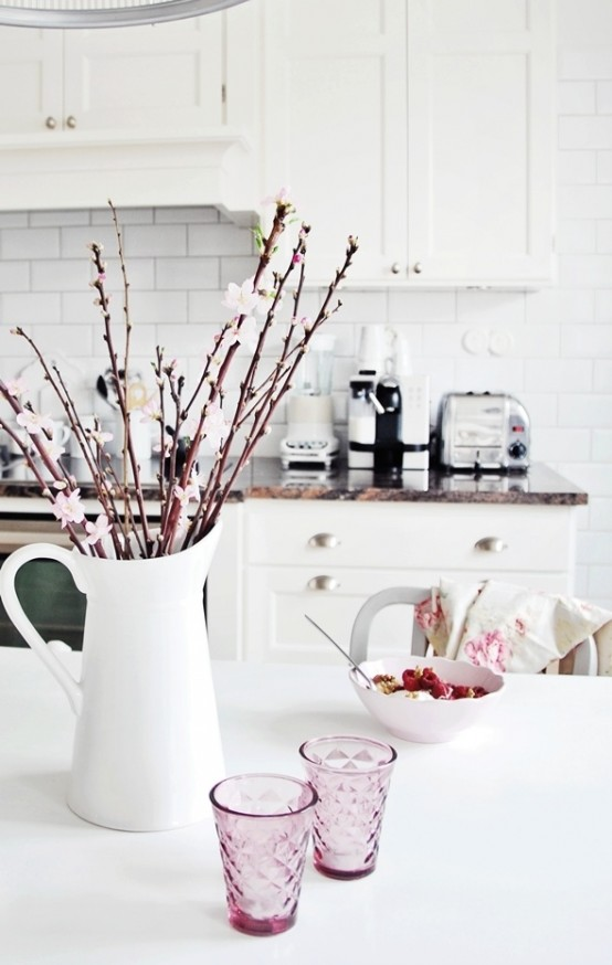 fresh cherry blossom in a jug will refresh your tablescape a lot and will make it look spring-like