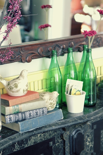 fake birds and some blooms are enough to style a mantel for spring with no fuss