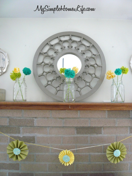 colorful pompom arrangements in jars, a bright paper garland for spring