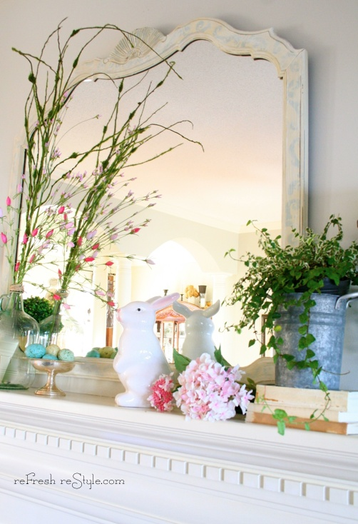 fake blooms and blooming branches, potted greenery and a bunny figurine