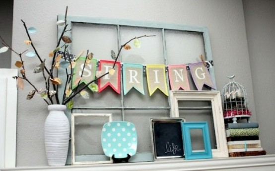 a colorful spring bunting, a decorative plate and a colorful branch arrangement