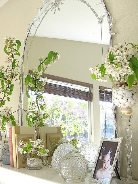lots of blooming branches and a large mirror - you won't need more to create a chic mantel for spring
