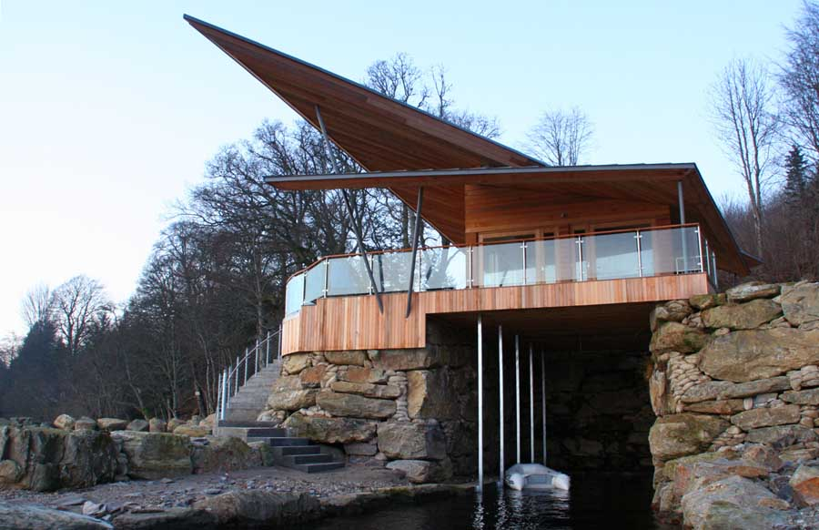 James Bond Inspired Boathouse Built Over A Cave Digsdigs