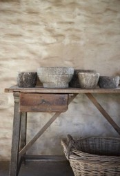 some rough stone bowls like these ones will add a wabi-sabi feel to the space at once