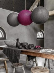 rough concrete walls, a rough wooden table and stools will make your dining space cooler