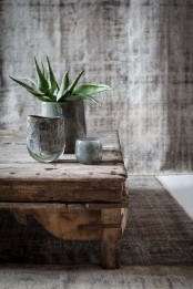 coarse fabric, a rough wooden table and glass vases and pots for creating a chic look