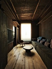 add wabi-sabi aesthetics to your space with stone walls, rough wooden touches and a metal ceiling