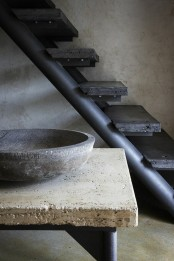 a stone bench plus a stone sink, a metal and stone staircase in black for adding minimal and wabi-sabi aesthetics