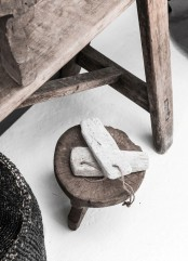 a wooden bench, a wooden stool and some wooden pieces on twine will make your space more wabi-sabi like