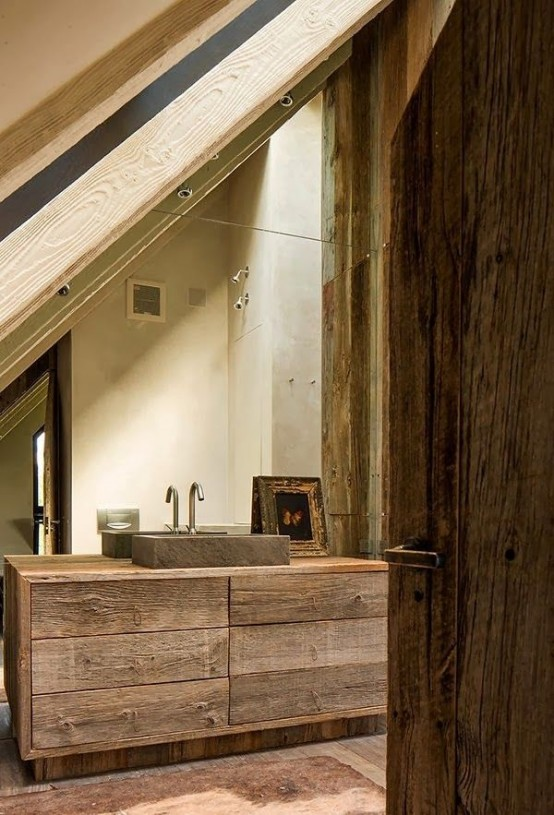 a wabi-sabi bathroom with rough wooden furniture, a stone sink and a vintage arwork looks impressive