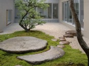 a fantastic Japanese inspired garden with pebbles, large flat rocks, moss and a couple of trees is very calming and soothing