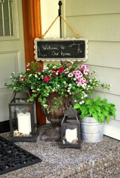 candle lanterns and potted blooms and greenery plus signage can be a nice fit for a tiny porch