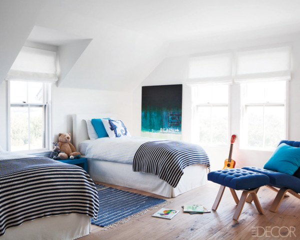 kids bedroom for two with a lounge chair and ottoman