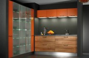 a contemporary kitchen with stained drawers, a grey backsplash and orange uppers, a glass fridge in orange