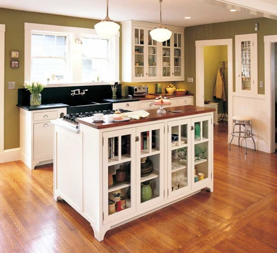 Transparent doors could make a kitchen island cabinets looks less massive.