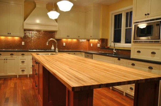 A butcher block island is a quite stylish solution for traditional kitchens.