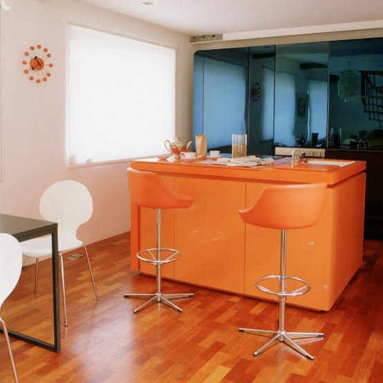 "Bright orange cabinetry would be a ""happy"" addition to any modern kitchen."