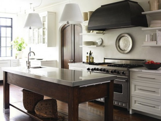 If you think a kitchen island is always bulky, just check this minimalist solution. Table-like support and a stone countertop have a very sophisticated and airy look.