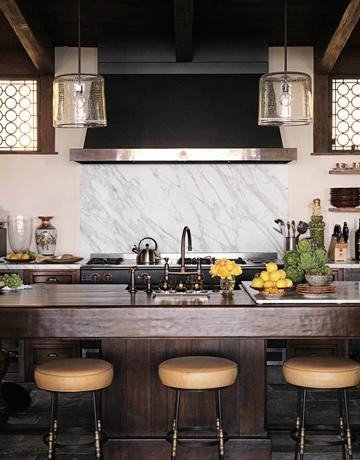 Natural wood is one of the best materials for a kitchen island. Just don't forget to add a durable countertop.