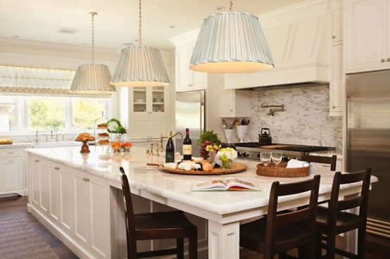 You can separate a long kitchen island into several zones: one for cooking, one for dining and one for storage.