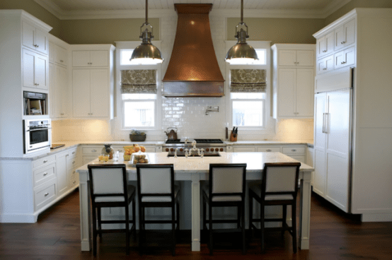 By combining several kitchen cabinets with two dining tables you can build a really functional kitchen island.