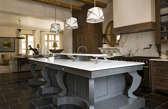 Large gorgeous kitchen island with gray wood support and white marble countertop. It's perfect for dining thanks to its size and an additional shelf in the middle where you could put plates with main dishes.