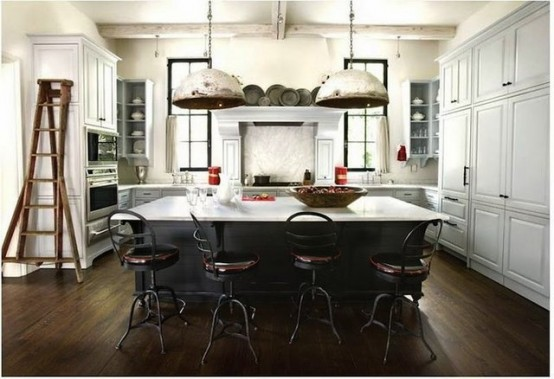 One more great example of marble coutertop and black cabinets that act as support. Vintage chairs and industrial pendant lights only add some charm to it.