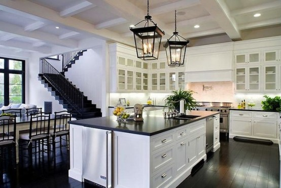 Black stone countertop with white cabinets is a more practical solution for a black kitchen.