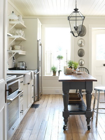 This is a really smart solution for any kitchen. A vintage looking tall table on casters. It can easily moved anywhere you like. You can use it as an additional dining surface or as for food  prep.