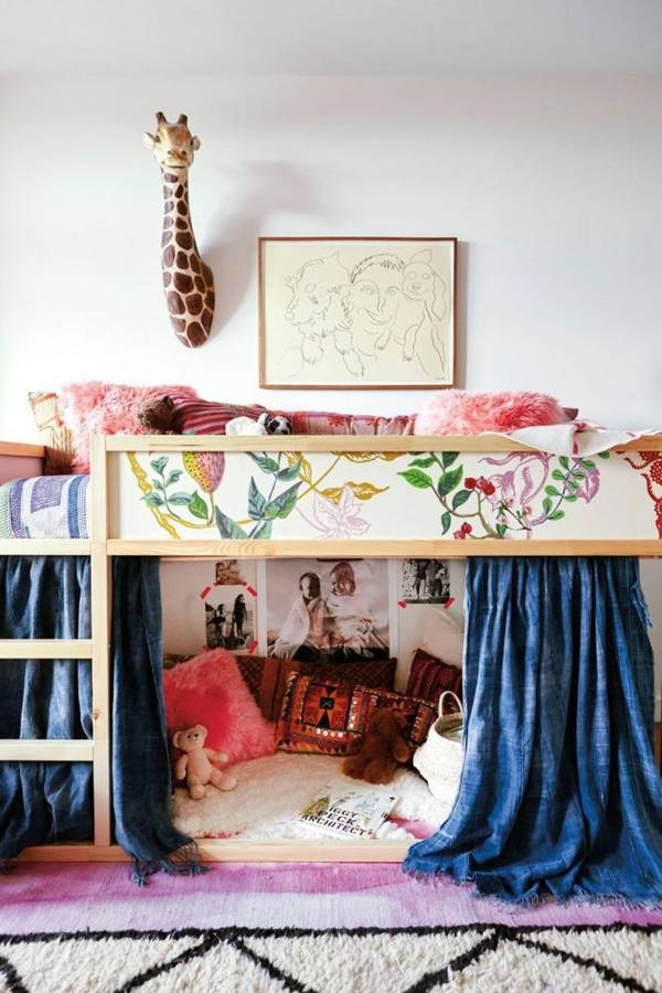 kura bed covered with scraps of floral wallpaper and with a cozy reading nook on the floor