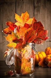 a jar with natural fall leaves is a lovely modern fall centerpiece you can make in a couple of minutes
