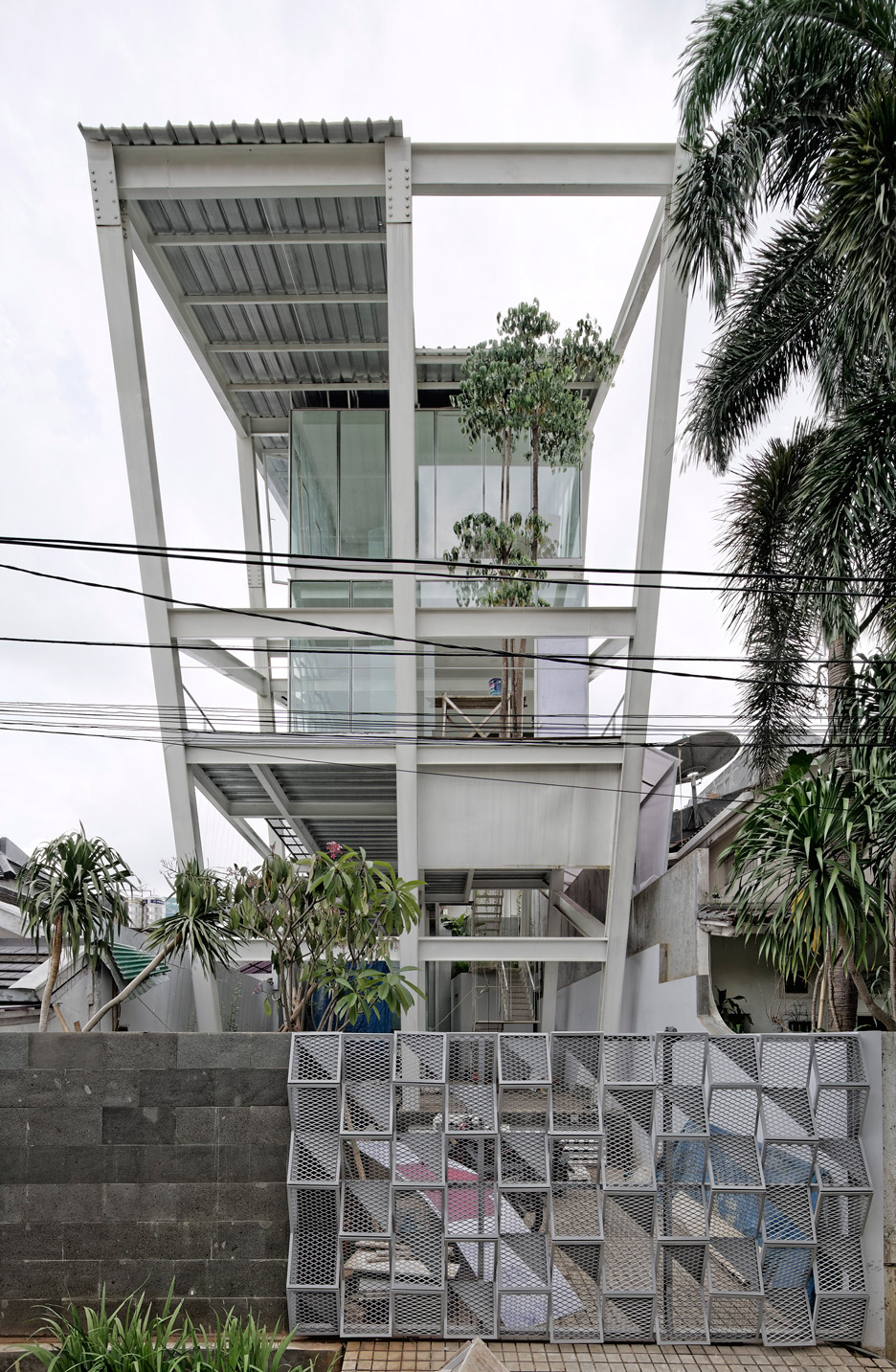 Leaning Rumah Miring House With Minimalist Decor