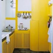 an yellow kitchen design for a modern home