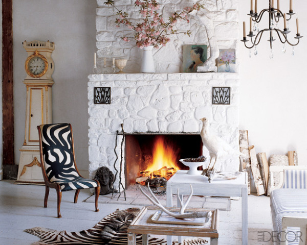 Living Room With A Fireplace Surrounded Painted Fieldstone