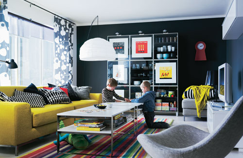 Living Room With Colorful Furniture And Black Walls