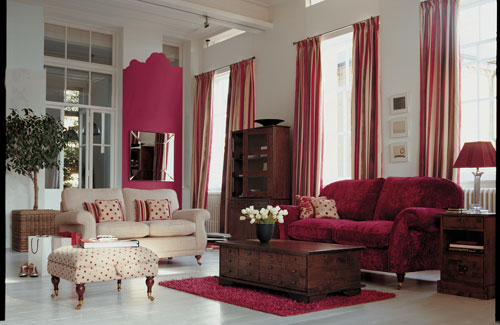 Living Room With Deep Reds Complementing Brown Furniture