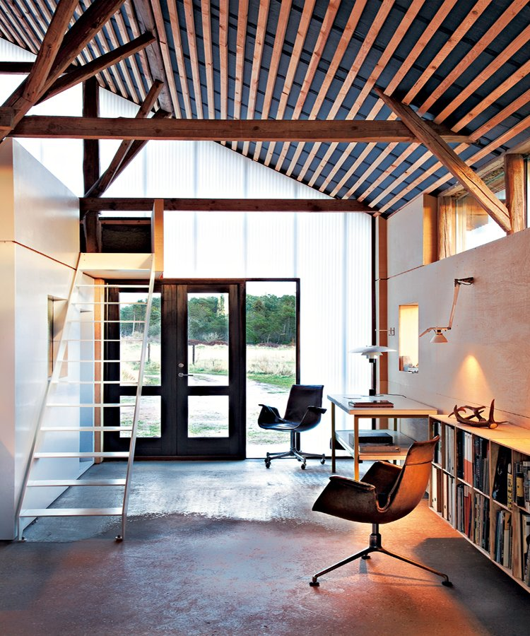 Loft like industrial house with energetic interiors in for Modern barn home interiors