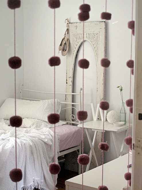 purple pompom curtains will help you divide the spaces without spending too much money or applying too much effort