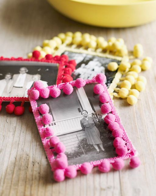 old family photos covered wiht bright red, yellow and pink pompoms to make them cool, bright and more modern
