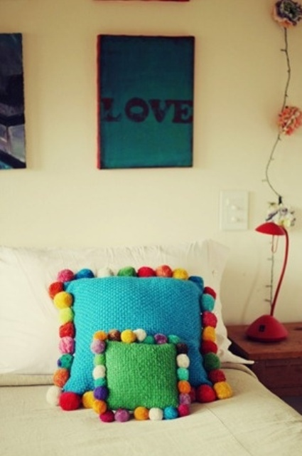 bright pillows with colorful pompom edges will give a fun and relaxed touch to the space