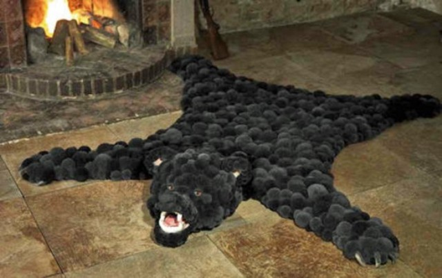 a faux animal skin fully made of black pompoms is a fun and eco friendly way to incorporate animal items into decor