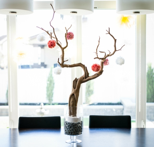 a dried tree with colorful pompoms is a creative interior decoration that will last as long as you want that