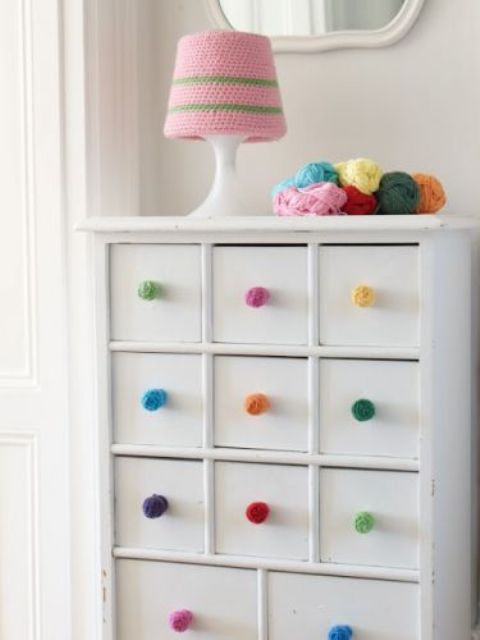 colorful pompom knobs and a colorful crochet lampshade for cozying up the interior and make it fun