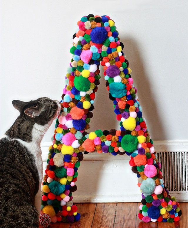 a colorful pompom monogram is a lovely and easy to make decoration to personalize your interior